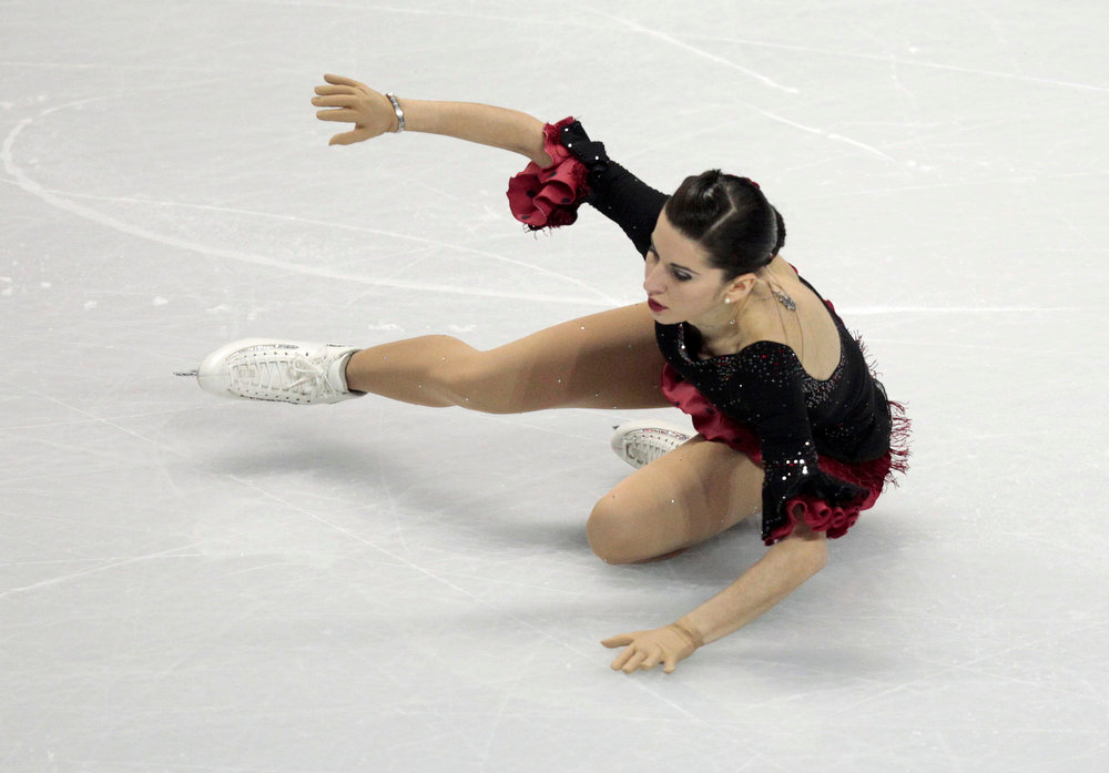 . Valentina Marchei of Italy falls during the Ladies Short Program at the ISU World Figure Skating Championships in London, Ontario, March 14, 2013.  REUTERS/Fred Thornhill