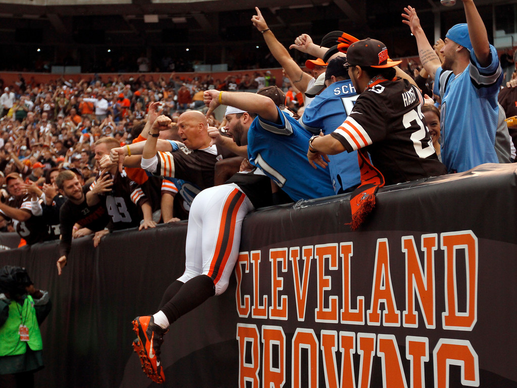 . Sam Greene/The Morning Journal Browns running back Chris Ogbonnaya (25) leaps into the stands after making a touchdown catch during the second quarter of the NFL week six game between the Cleveland Browns and Detroit Lions at FirstEnergy Stadium in Cleveland, Ohio, on Sunday, Oct. 13, 2013. Ogbonnaya accounted for 61 yards receiving and 24 on the ground against the Lions.