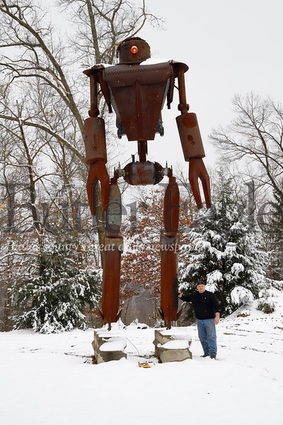 Local metal-works artist Bill Secunda stands next to one of his favorite works, a nearly 30-foot tall robot sculpture. The sci-fi enthusiat sculpts everything from lions, buffalo and cowboys to his recent Donald Trump piece. Seb Foltz/Butler Eagle