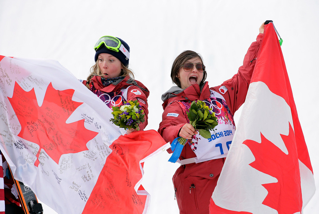 . Canada\'s Dara Howell, left, celebrates with compatriot  Kim Lamarre after Howell took  the gold medal in the women\'s freestyle skiing slopestyle final at the Rosa Khutor Extreme Park at the 2014 Winter Olympics, Tuesday, Feb. 11, 2014, in Krasnaya Polyana, Russia.  Lamarre took the bronze medal. (AP Photo/Andy Wong)