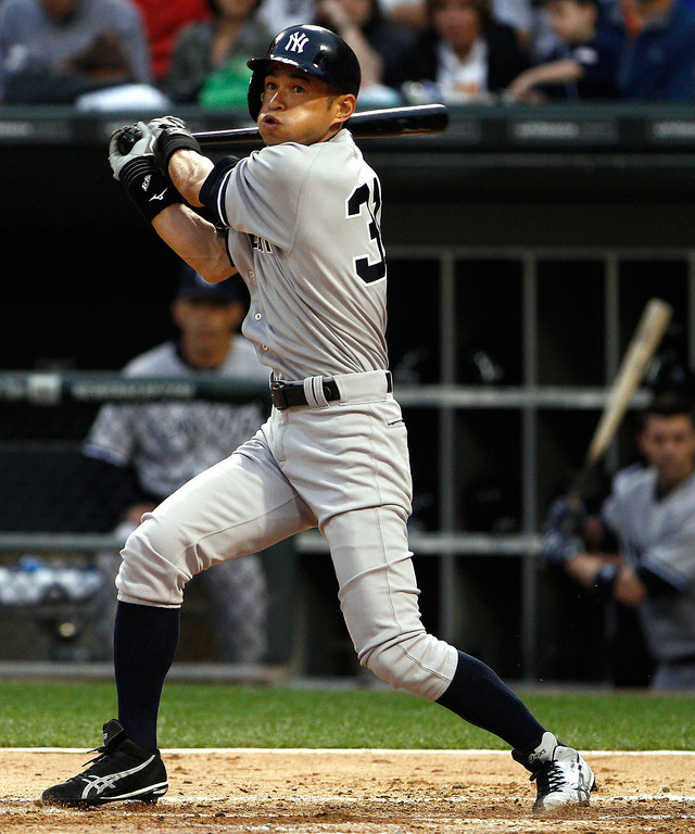 . New York Yankees\' Ichiro Suzuki hits a foul ball while batting in the second inning against the Chicago White Sox in a baseball game at US Cellular Field in Chicago on Monday, Aug. 5, 2013. (AP Photo/Charles Cherney)
