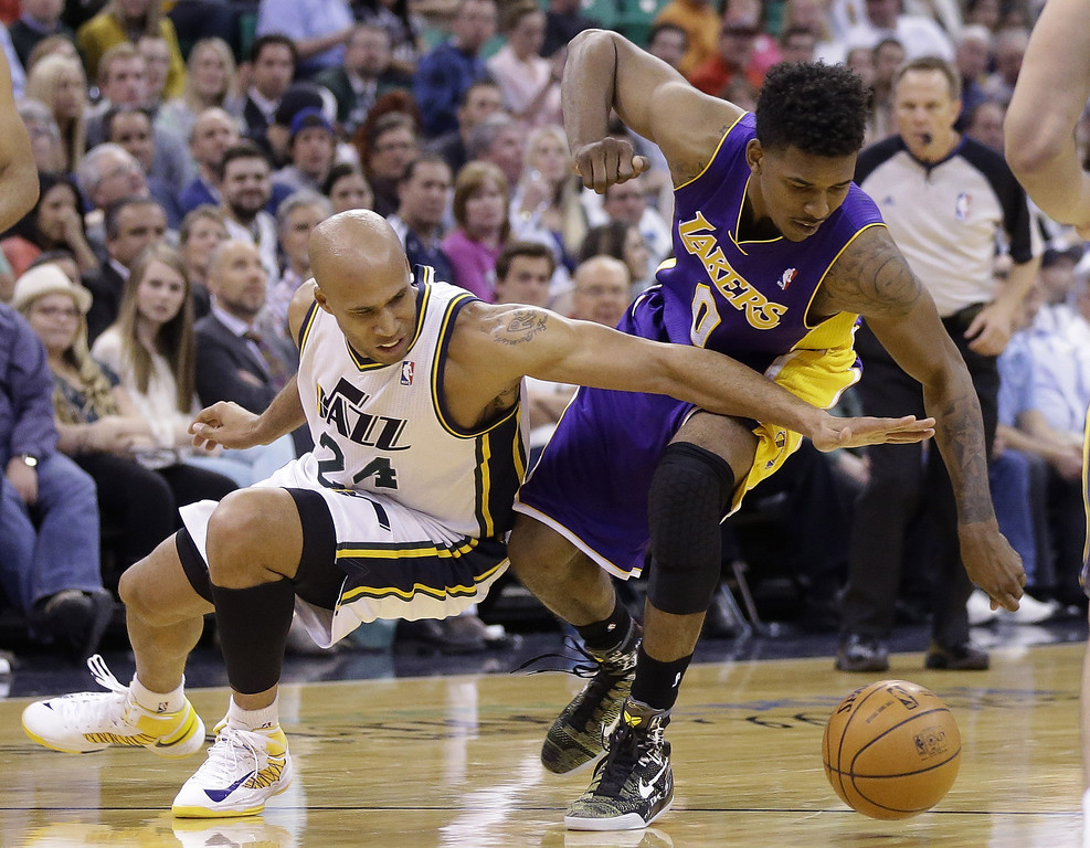 . Utah Jazz\'s Richard Jefferson (24) and Los Angeles Lakers Nick Young (0) battle for a loose ball in the second quarter during an NBA basketball game Monday, April 14, 2014, in Salt Lake City, Utah. (AP Photo/Rick Bowmer)