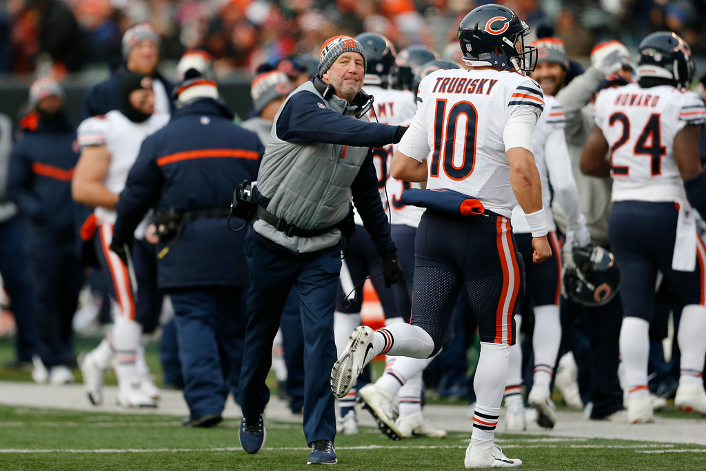 . Chicago Bears head coach John Fox, center, celebrates with quarterback Mitchell Trubisky (10) after Trubisky\'s touchdown run in the second half of an NFL football game against the Cincinnati Bengals, Sunday, Dec. 10, 2017, in Cincinnati. (AP Photo/Gary Landers)
