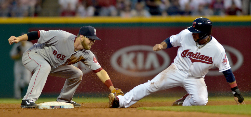 . Jeff Forman/JForman@News-Herald.com Mike Aviles beats the tag from Boston short stop Steven Drew in the seventh  inning of the Indians\' 3-2 win over the Red Sox June 2 at Progressive Field. Boston lost a challenge on the call.