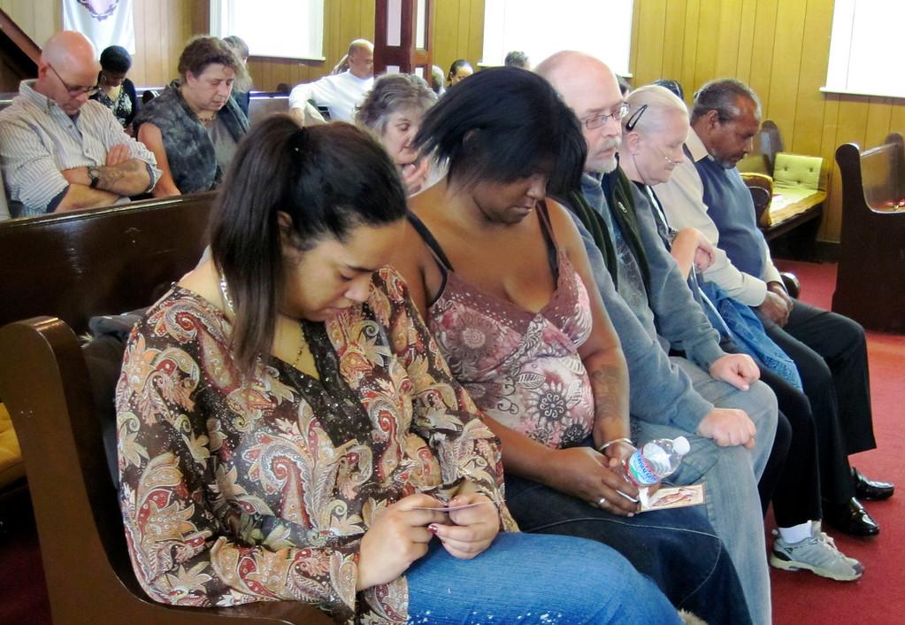. Friends of David Glasser pray at Price Memorial AME Zion Church of Pittsfield at Glasser\'s memorial.  Mon Nov 28, 2011 (GARVER)