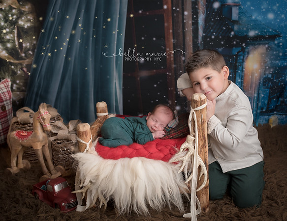 Baby's First Christmas with adoring big brother