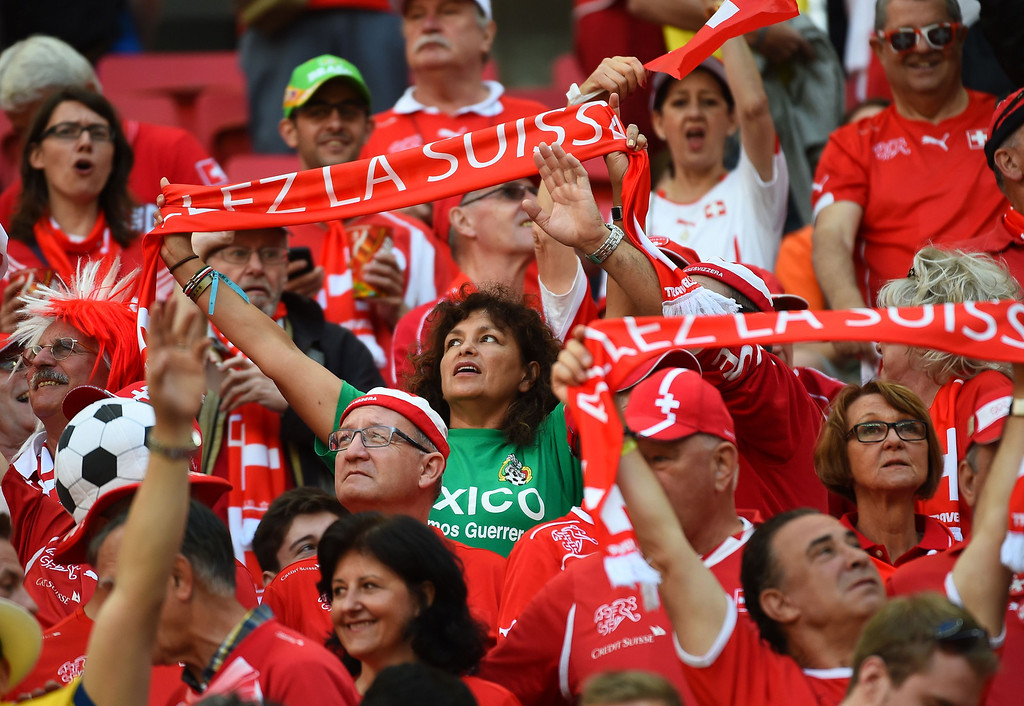 . Swiss fans react during a Group E football match between Switzerland and Ecuador at the Mane Garrincha National Stadium in Brasilia during the 2014 FIFA World Cup on June 15, 2014. Switzerland won 2-1.    AFP PHOTO/ ANNE-CHRISTINE POUJOULAT