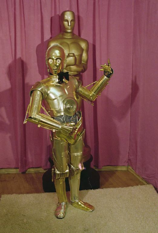 . C-3PO, the robot character from the fictional Star Wars universe, is shown in front of  a giant Oscar at the 50th Academy Awards in Los Angeles, April 3, 1978. (AP Photo)