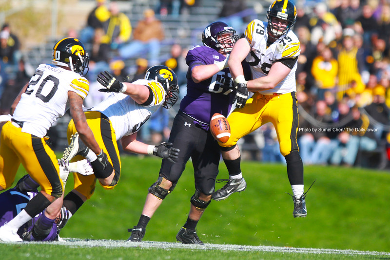 Iowa defensive lineman Dominic Alvis deflects a pass from quarterback Kain Colter during the game against Northwestern at Ryan Field, in Evanston, Illinois on Saturday, October 27, 2012. Northwestern Wildcats defeated Iowa Hawkeyes, 28-17. (The Daily Iowan/Sumei Chen)