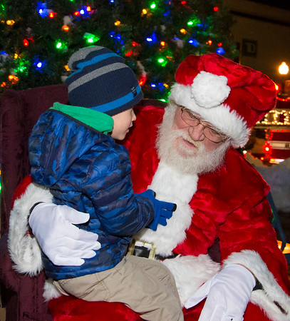 12/05/19 Wesley Bunnell | Staff The New Britain Christmas tree was lit on Thursday night in Central Park complete with a visit from Santa Clause who rode in on a NBFD fire truck. James Ciccarillo, age 3, who helped light the tree discusses his gift wishes with Santa.