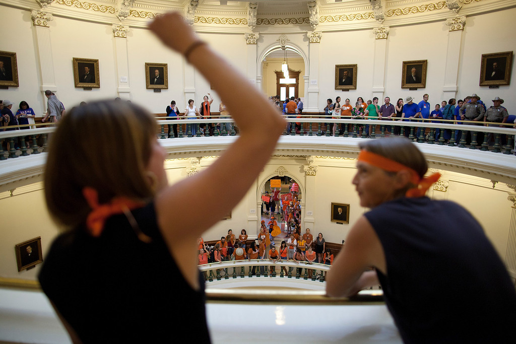 . Hallie Boas and Lisa Fithian lead abortion rights chants from the third floor of the Texas Capitol Rotunda in Austin, Texas on Friday, July 12, 2013. The Texas Senate\'s leader, Lt. Gov. David Dewhurst, has scheduled a vote for Friday on the same restrictions on when, where and how women may obtain abortions in Texas that failed to become law after a Democratic filibuster and raucous protesters were able to run out the clock on an earlier special session. (AP Photo/Tamir Kalifa)