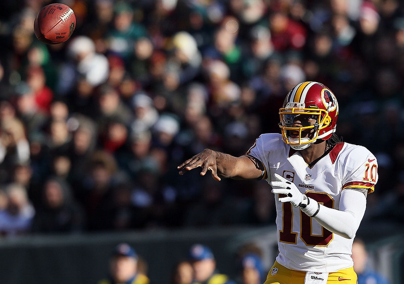 . Robert Griffin III #10 of the Washington Redskins makes a pass against the Philadelphia Eagles during the first quarter at Lincoln Financial Field on December 23, 2012 in Philadelphia, Pennsylvania.  (Photo by Alex Trautwig/Getty Images)