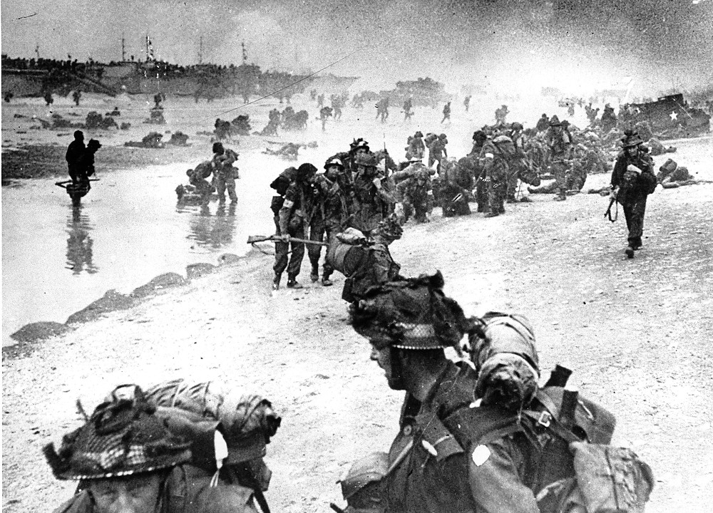 Description of . In this photo provided by the British Navy, wounded British troops from the South Lancashire and Middlesex regiments are being helped ashore at Sword Beach, June 6, 1944, during the D-Day invasion of German occupied France during World War II.  (AP Photo/British Navy)