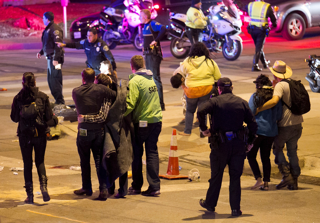 . People walk away after the accident on Red River Street in downtown Austin, Texas, that left two dead at SXSW on Wednesday March 12, 2014.  (AP Photo/Austin American-Statesman, Jay Janner)