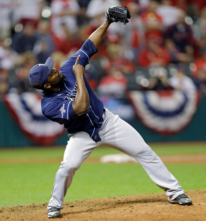 . Tampa Bay Rays relief pitcher Fernando Rodney celebrates after the final out in the Rays\' 4-0 win over the Cleveland Indians in the AL wild-card baseball game Wednesday, Oct. 2, 2013, in Cleveland. (AP Photo/Tony Dejak)