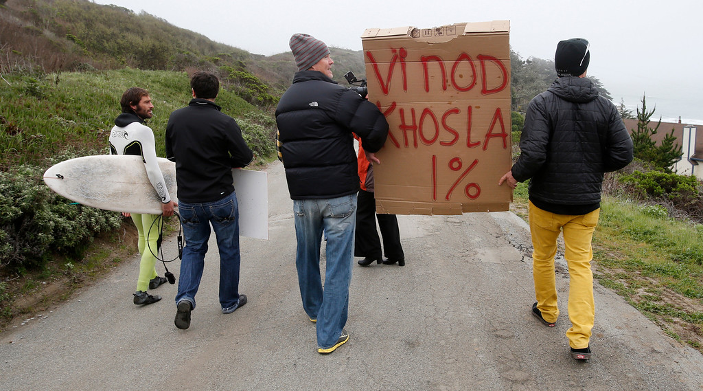 . Activists walk to  Martin\'s Beach in Half Moon Bay, Calif., on Thursday, March 14, 2013. Martin\'s Beach was closed to public access in 2008 when the property was purchased by venture capitalist Vinod Khosla.