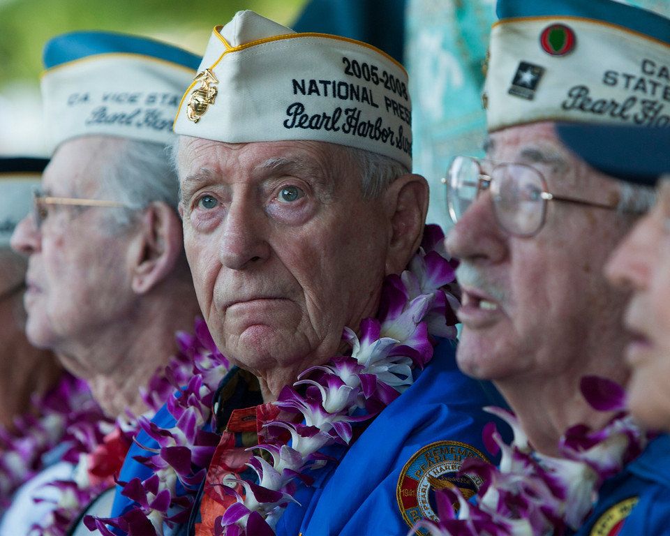 . Pearl Harbor survivor Mal Middlesworth, center, sits with other Pearl Harbor survivors before the start of ceremony commemorating the 72nd anniversary of the attack on Pearl Harbor, Saturday, Dec. 7, 2013, in Honolulu.  (AP Photo/Marco Garcia)