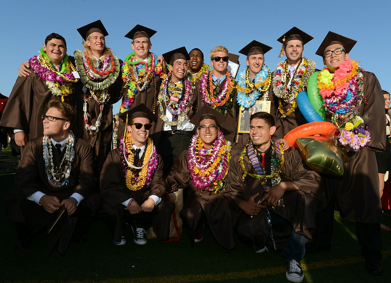 ". ""Members of the West HS football team pose for family and friends.