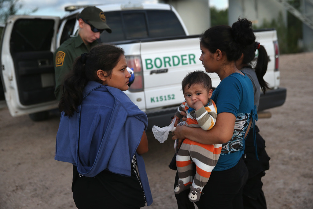 . Families of Central American immigrants turn themselves in to U.S. Border Patrol agents after crossing the Rio Grande River from Mexico on September 8, 2014 to McAllen, Texas. Although the numbers of such immigrant families and unaccompanied minors have decreased from a springtime high, thousands continue to cross in the border illegally into the United States. The Rio Grande Valley sector is the busiest area for illegal border crossings, especially for Central Americans, into the U.S.  (Photo by John Moore/Getty Images)