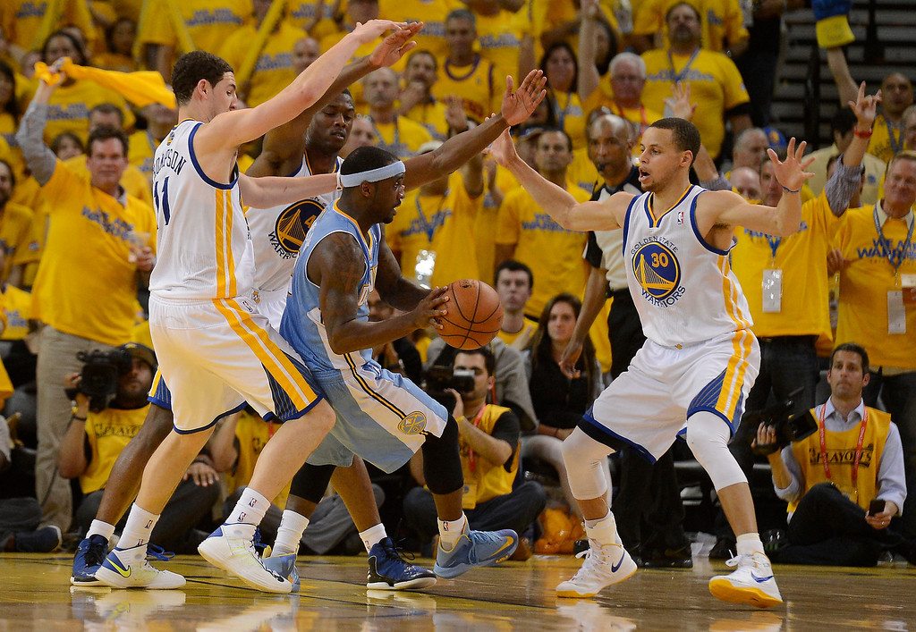 . Ty Lawson (3) of the Denver Nuggets gets triple teamed by Klay Thompson (11) of the Golden State Warriors Harrison Barnes (40) and Stephen Curry (30) during the fourth quarter in Game 4 of the first round NBA Playoffs April 28, 2013 at Oracle Arena. (Photo By John Leyba/The Denver Post)