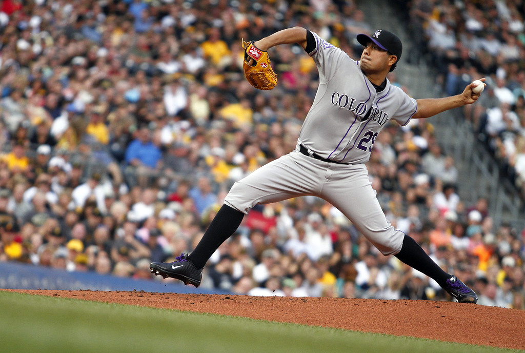 . PITTSBURGH, PA - AUGUST 03:  Jorge De La Rosa #29 of the Colorado Rockies pitches in the first inning against the Pittsburgh Pirates during the game on August 3, 2013 at PNC Park in Pittsburgh, Pennsylvania.  (Photo by Justin K. Aller/Getty Images)