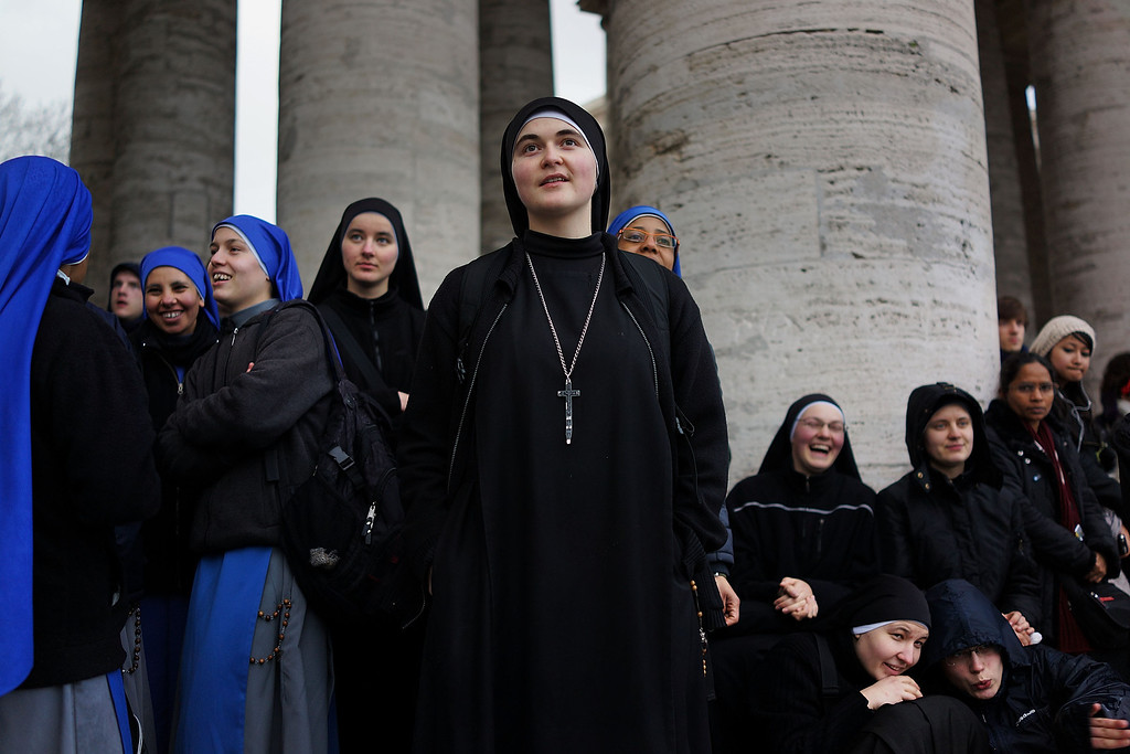 . A group of nuns join hundreds of others as they await news of whether the College of Cardinals have elected a new Pope in St. Peter\'s Square on March 12, 2013 in Vatican City, Vatican. (Photo by Spencer Platt/Getty Images)
