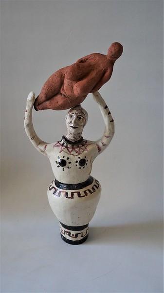 Maria Gimbutas as Bird Goddess holding up the Venus of Lespuge by Frances Guerin