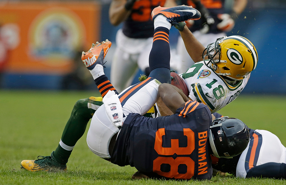 . Chicago Bears defensive back Zack Bowman (38) tackles Green Bay Packers wide receiver Randall Cobb (18) in the second half of an NFL football game in Chicago, Sunday, Dec. 16, 2012. The Packers won 21-13 to clinch the NFC North division title. (AP Photo/Nam Y. Huh)