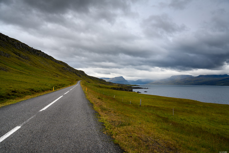 A road under a cloudy sky
