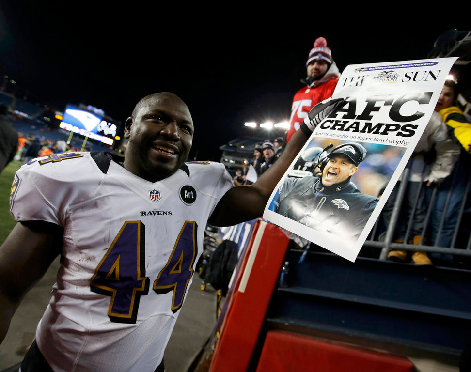 . Baltimore Ravens\' Vonta Leach celebrates with a newspaper headline after his team defeated the New England Patriots in the NFL AFC Championship football game in Foxborough, Massachusetts, January 20, 2013. REUTERS/Mike Segar
