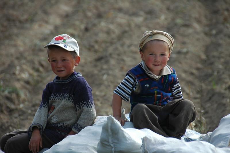 Kyrgyz Kids on Potato Sacks - Issyk-Kul, Kyrgyzstan
