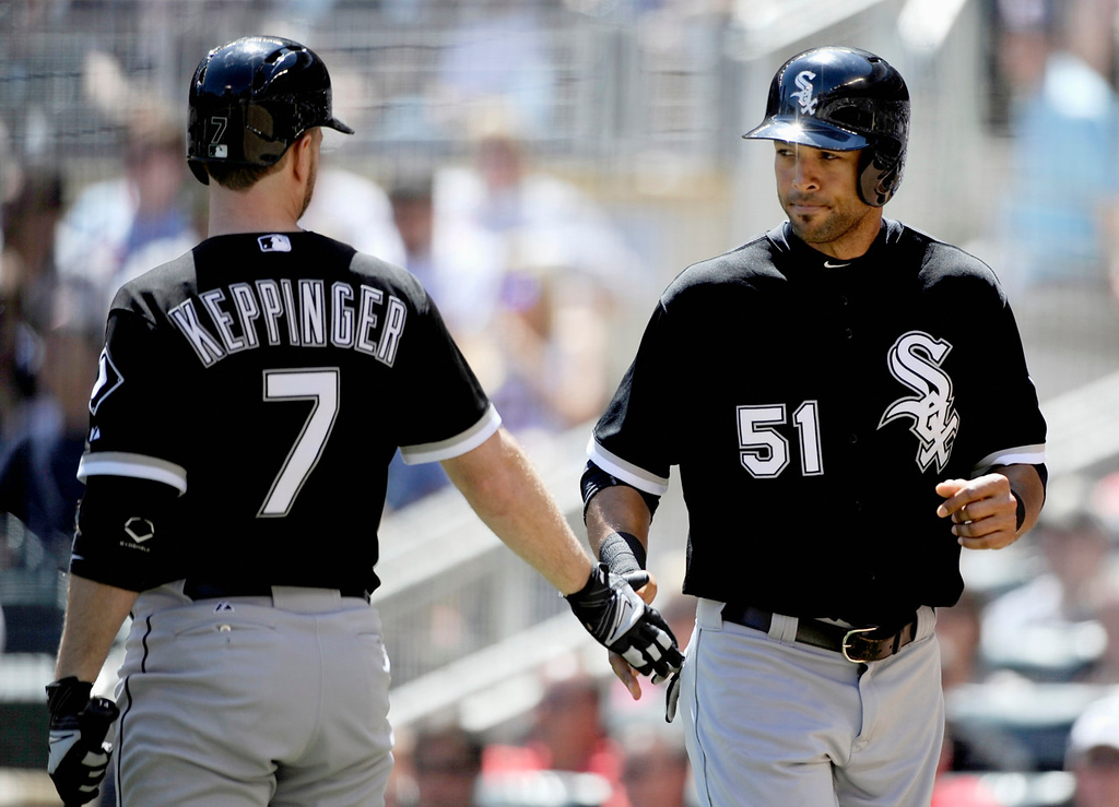 . Chicago\'s Jeff Keppinger, left, congratulates teammate Alex Rios, who scored on a sacrifice fly by Dayan Viciedo against the Twins during the fifth inning. (Photo by Hannah Foslien/Getty Images)