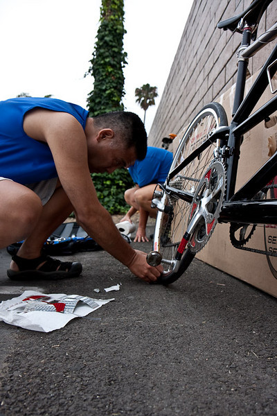 Gary puts on the finishing touches.  The rules required the bike to have a lot of reflective tape added.