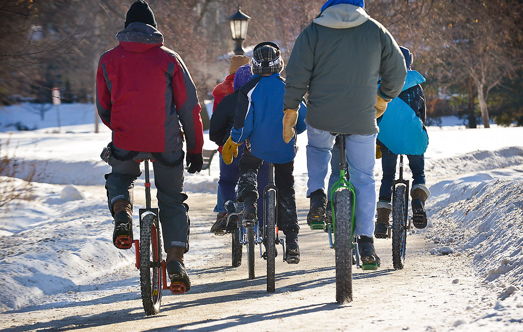 . After practicing their downhill skills, unicycle club members continued around the lake. (Pioneer Press: Ben Garvin)