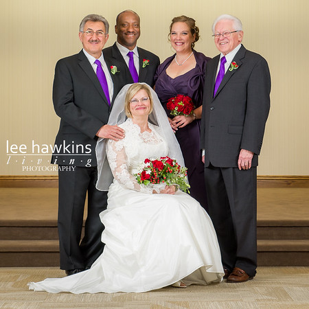Formal portrait of bride and groom with bridal party