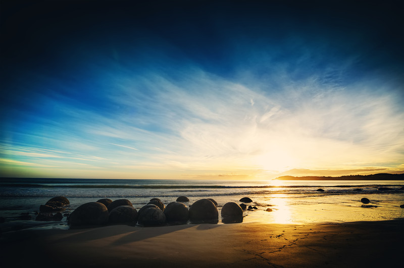 The Coastal Boulders These boulders in Moeraki are beautiful any time of the day, but morning is the best time to get this kind of light. Since it faces the ocean to the east, that morning sun comes blasting out right behind them. But no worries, if you can't master-plan your visit to that degree, this area is beautiful any time of the day.- Trey RatcliffClick here to read the rest of this post at the Stuck in Customs blog.