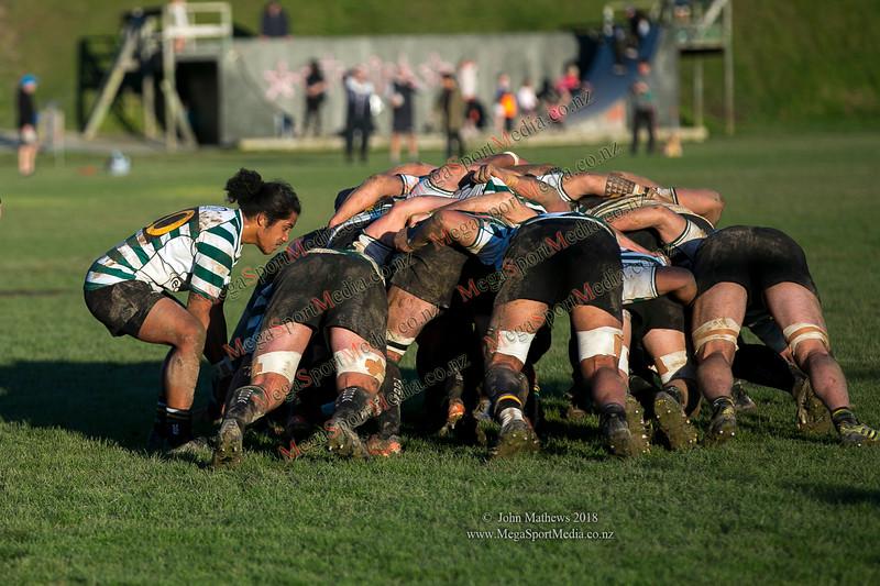 Action from the Wellington Premier  rugby union match (Swindale Shield) between Old Boys University RFC (white) and Petone (blue) at Nairnville Park, Wellington, New Zealand on 2 June 2018. SCORE: Petone 5, OBU 19 Copyright John Mathews 2018 www.megasportmedia.co.nz