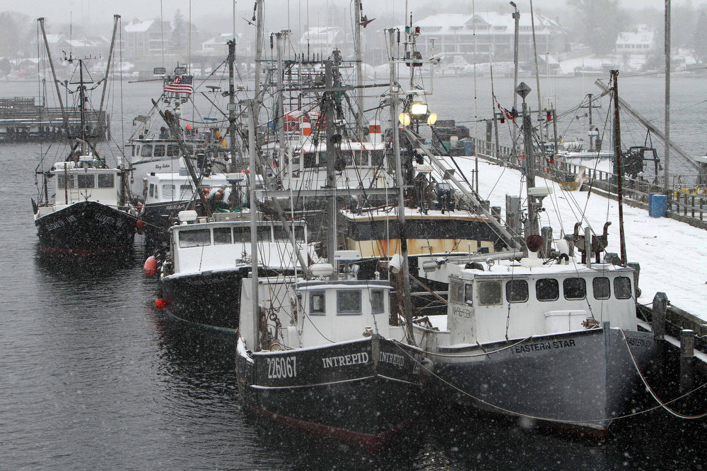. Snow falls on fishing boats at the state fishing pier in Portsmouth, N.H., Friday, Feb. 8, 2013. Fisherman are staying off the water in the Northeast as a major snowstorm moves in. (AP Photo/Jim Cole)