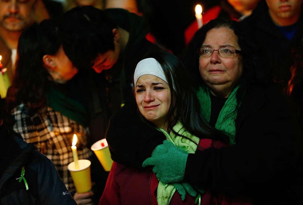 . Donna Soto (R), mother of Victoria Soto, the first-grade teacher at Sandy Hook Elementary School who was shot and killed while protecting her students, hugs her daughter Karly (second from right) while mourning their loss with Victoria\'s other two siblings, Jillian (far left) and Matthew Soto (second from left), at a candlelight vigil at Stratford High School on December 15, 2012 in Stratford, Connecticut. Twenty-six people were shot dead, including twenty children, after a gunman identified as Adam Lanza opened fire in the school. Lanza also reportedly had committed suicide at the scene. A 28th person, believed to be Nancy Lanza was found dead in a house in town, was also believed to have been shot by Adam Lanza. (Photo by Jared Wickerham/Getty Images)