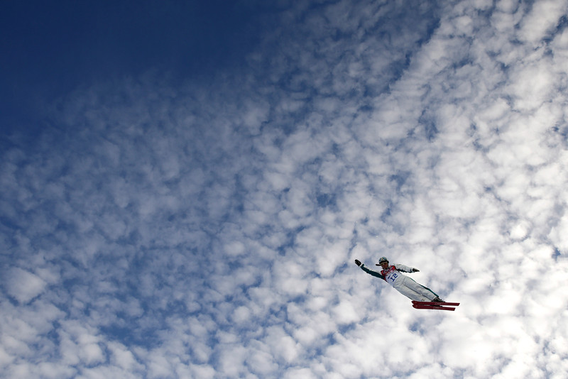 . Australia\'s Samantha Wells catches air during a training session for the women\'s freestyle skiing aerials at the Rosa Khutor Extreme Park, at the 2014 Winter Olympics, Friday, Feb. 14, 2014, in Krasnaya Polyana, Russia. (AP Photo/Jae C. Hong)