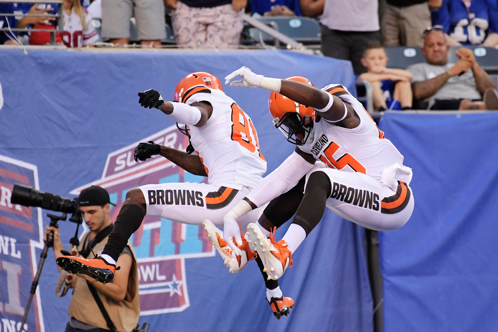 . Cleveland Browns\' David Njoku (85) celebrates with Rashard Higgins (81) after scoring a touchdown during the first half of a preseason NFL football game Thursday, Aug. 9, 2018, in East Rutherford, N.J. (AP Photo/Bill Kostroun)