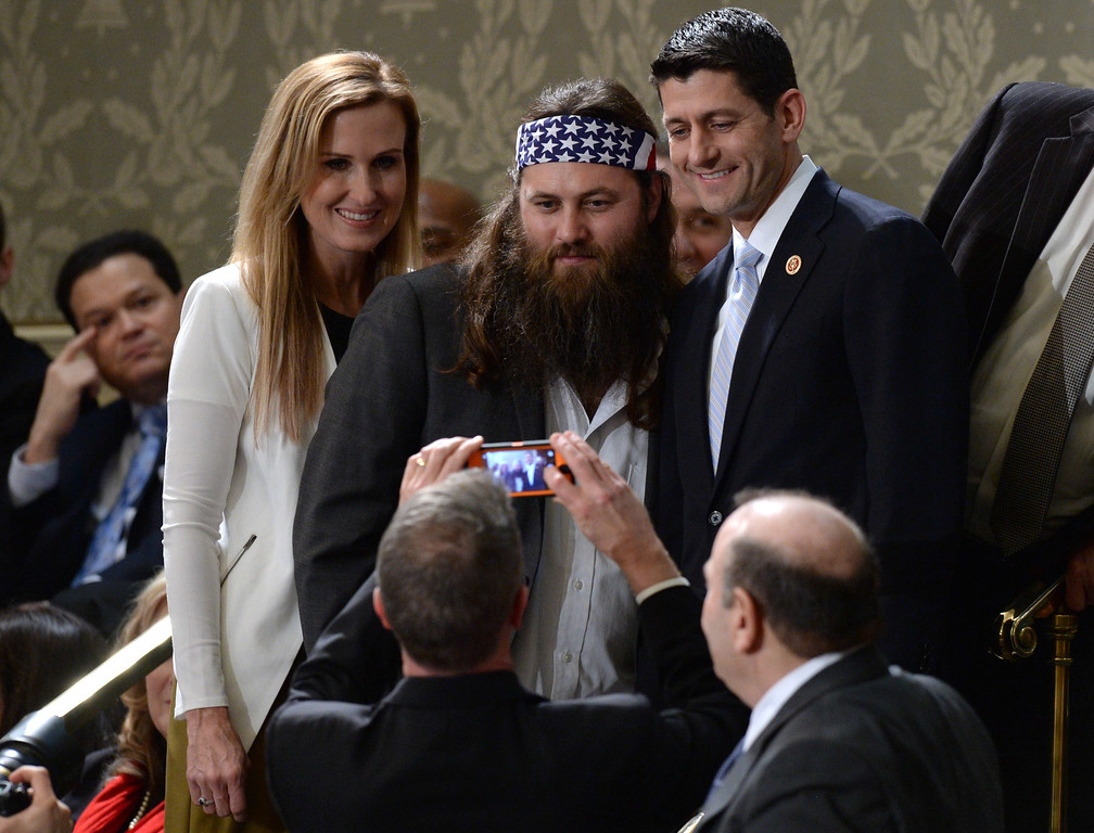 . Willie Robertson (C) of the television show Duck Dynasty poses for a picture with US Repubklican Representative from Wisconsin Paul Ryan (R) and his wife Janna Ryan before US President Barack Obama delivers his State of the Union address before a joint session of Congress on January 28, 2014 at the US Capitol in Washington. JEWEL SAMAD/AFP/Getty Images
