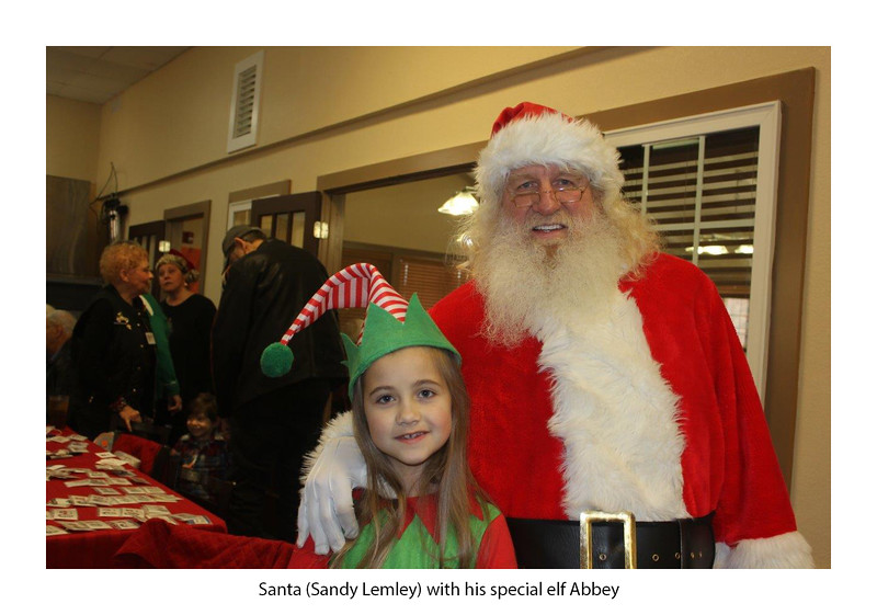 Santa (Sandy Lemley) and his special elf, Abbey.jpg
