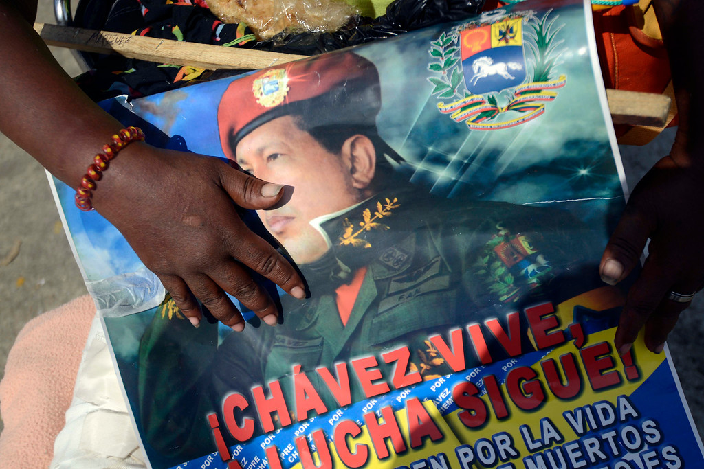 . Supporters of late Venezuela\'s President Hugo Chavez await their turn to pay their last homage to their leader, in Caracas, on March 7, 2013.   AFP PHOTO/LEO RAMIREZ/AFP/Getty Images