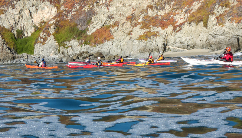 About 22 kayakers endured harsh conditions that required sunscreen, sunglasses, and moderate skills.