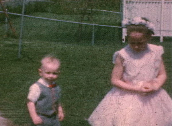 a still taken from super8 movie, backyard at 908 Rynex Drive, Easter, 1961 (or 1962)