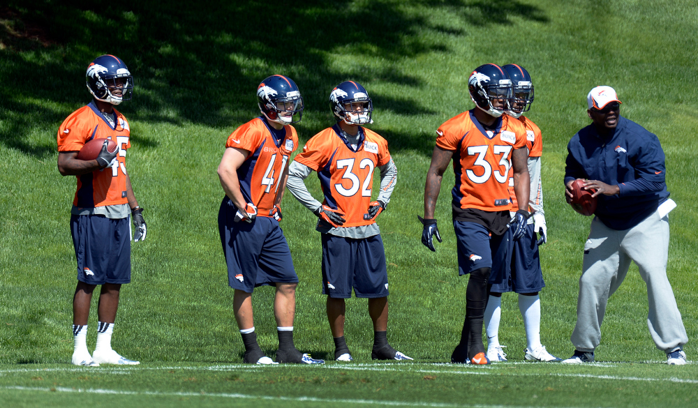 . Denver Broncos  defensive backs Dominique Rodgers-Cromatie (45) Ross Ransner (41) Tony Carter (32) Duke Ihenacho (33) look on during the teams OTAs May 20, 2013 at Dove Valley. All offseason training activities (OTAs) are voluntary until the mandatory minicamp June 11-13. (Photo By John Leyba/The Denver Post)