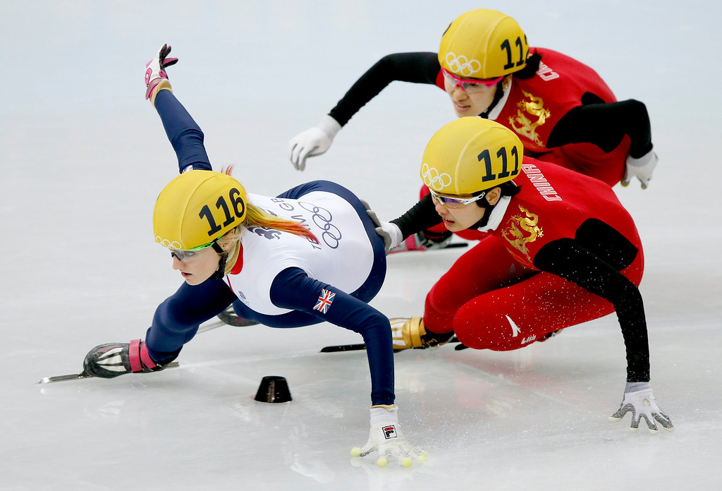 . Elise Christie (L) of Great Britain leads Li Jianrou (C) and Liu Qiuhon of China to win semi final 2 in women\'s 500m of the Short Track events in the Iceberg Skating Palace at the Sochi 2014 Olympic Games, Sochi, Russia, 13 February 2014.  EPA/BARBARA WALTON