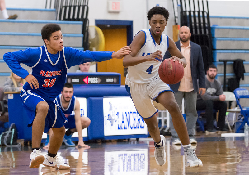 01/07/19  Wesley Bunnell   Staff  Bristol Eastern boys basketball in a home game vs Plainvillle on Monday night. Javan Paradis (30) and Jahcyrus Lawrence-Bynum (4).