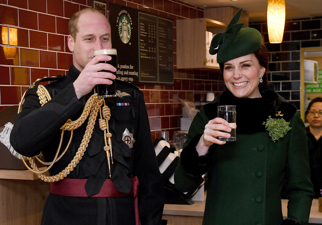 . Britain\'s Kate, the Duchess of Cambridge, smiles as she and Prince William toast, as they visit the 1st Battalion Irish Guards, for the St. Patrick\'s Day Parade, at Cavalry Barracks, in Hounslow, England, Saturday, March 17, 2018.  (Andrew Parsons/Pool Photo via AP)